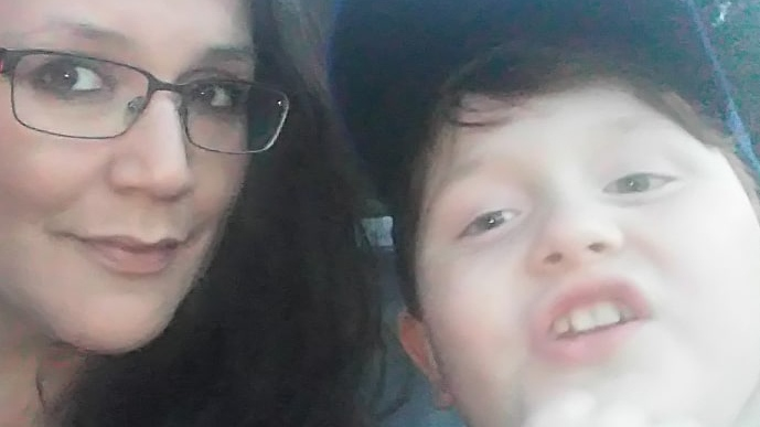 Nicole Taitinger and her son Oscar are seen in an undated image provided by the family.