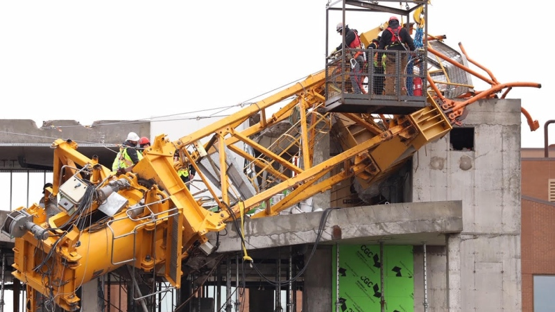 The final pieces of a crane, shown in a handout photo, that collapsed onto a building in Halifax last month, during post-tropical storm Dorian, have been removed. A government release says the pieces that were lying on the top storey of the Olympus building were removed Saturday, Oct.26, 2019. (THE CANADIAN PRESS/Nova Scotia Government)
