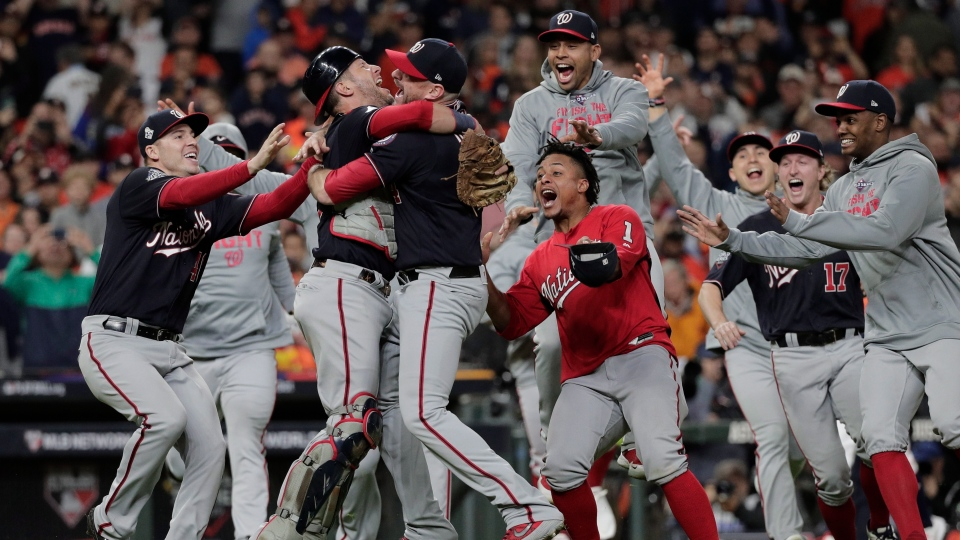 Washington Nationals' Yan Gomes and Daniel Hudson celebrate after Game 7 of the baseball World Series against the Houston Astros Wednesday, Oct. 30, 2019, in Houston. (AP Photo/David J. Phillip)