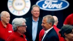 FILE - In this Monday, July 15, 2019, file photo, United Auto Workers Local 600 President Bernie Ricke, left, talks with Ford Motor Co., President Automotive Joseph R. Hinrichs after opening contract talks in Dearborn, Mich. (AP Photo/Carlos Osorio, File)