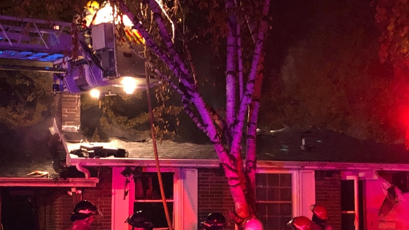 Fire crews work to extinguish hot spots in a house fire on Briarhill Avenue. (Justin Zadorsky / CTV London)