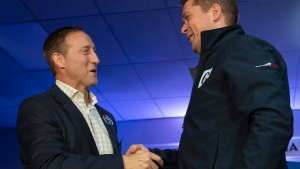 Conservative leader Andrew Scheer, right, shakes hands with Peter MacKay during a campaign stop in Little Harbour, N.S. Thursday October 17, 2019.  THE CANADIAN PRESS/Adrian Wyld