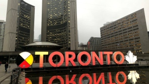 The Toronto sign is seen lit up in orange for Halloween on Oct. 31, 2019 outside of city hall. (Twitter / @JohnTory)