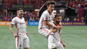 Toronto FC midfielder Nicolas Benezet (7) celebrates with forward Tsubasa Endoh (31) after scoring a goal against Atlanta United during the first half of the MLS soccer Eastern Conference final Wednesday, Oct. 30, 2019 in Atlanta. Toronto won 2-1. (AP Photo/John Bazemore)