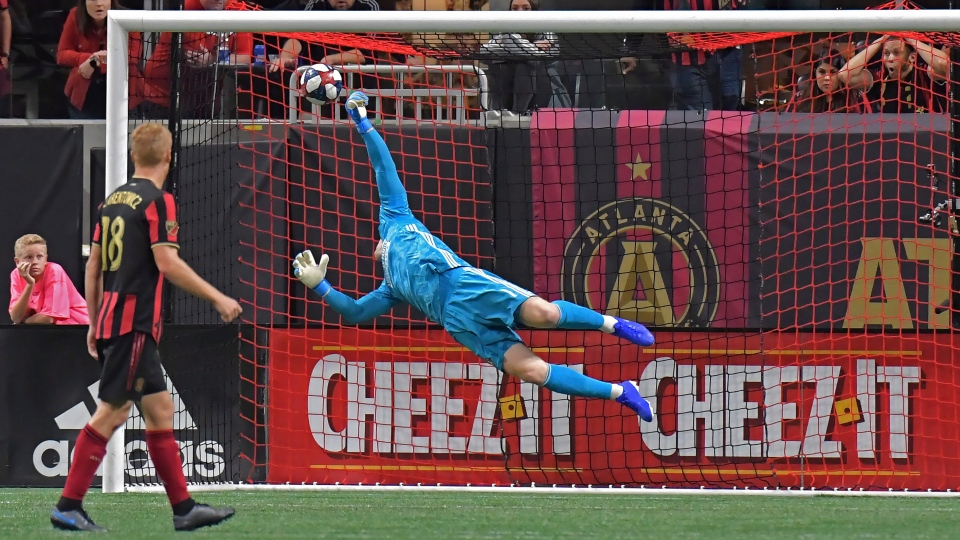 Atlanta United goalkeeper Brad Guzan (1) is not able to stop a goal by Toronto FC midfielder Nick DeLeon, not seen, during the second half of the MLS soccer Eastern Conference final Wednesday, Oct. 30, 2019, in Atlanta. Toronto FC won 2-1. (Hyosub Shin/Atlanta Journal-Constitution via AP)