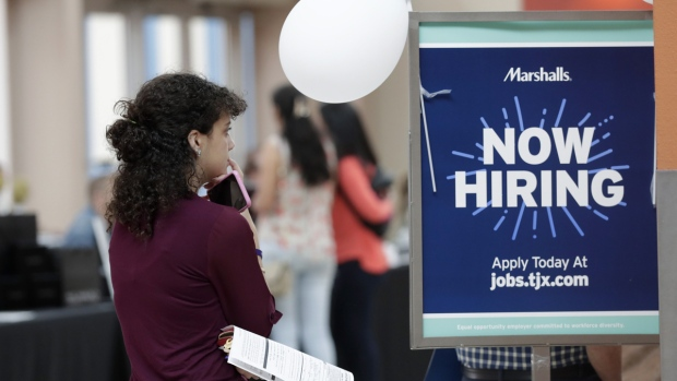 Job Growth Slows Less Than Expected as Payrolls Rise 128,000