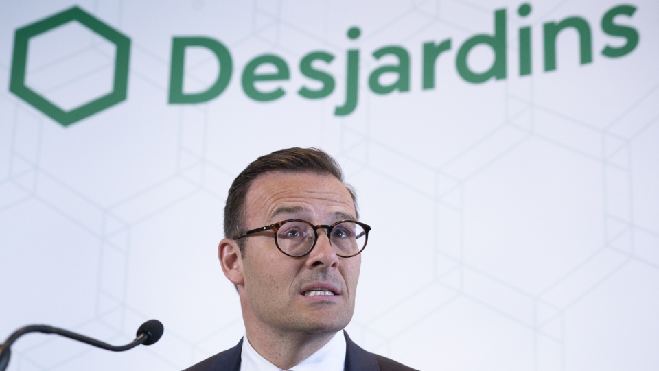 Desjardins President and CEO Guy Cormier reads a statement during a news conference in Montreal on June 20, 2019. THE CANADIAN PRESS/Paul Chiasson