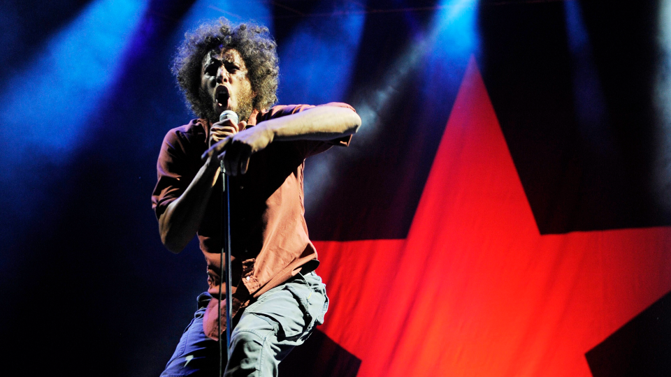 Zack de la Rocha of the band Rage Against the Machine performs during the band's headlining set at the