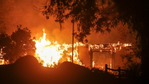 A wildfire burns in Riverside, Calif. Thursday, Oct. 31, 2019. (AP Photo/Ringo H.W. Chiu)