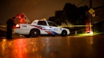 Toronto Police officers cordoned off an area around an apartment building in Toronto on Wednesday, Oct. 30, 2019. Toronto police say five teens have been shot in the western part of the city in a targeted shooting. THE CANADIAN PRESS/ Cole Burston