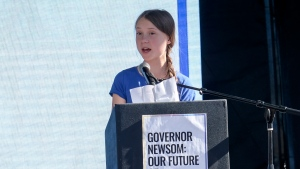 Climate change activist Greta Thunberg speaks after a climate change march in Los Angeles on Friday, Nov. 1, 2019. Thunberg says young people are rallying to fight climate change because their age leaves them with the most to lose from damage to the planet. (AP Photo/Ringo H.W. Chiu)