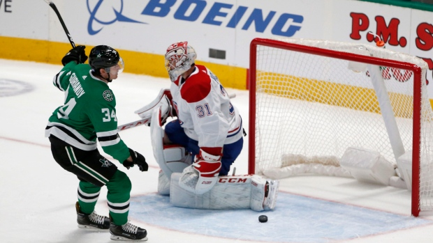 Dallas Stars right wing Denis Gurianov (34) scores a penalty shot goal against Montreal Canadiens goaltender Carey Price (31) during the second period of an NHL hockey game in Dallas, Saturday, Nov. 2, 2019. (AP Photo/Michael Ainsworth)