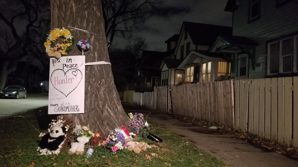A memorial for Hunter Haze Smith-Straight is growing outside of the Pritchard Ave. house where the boy was attacked. (Dan Timmerman/CTV News)
