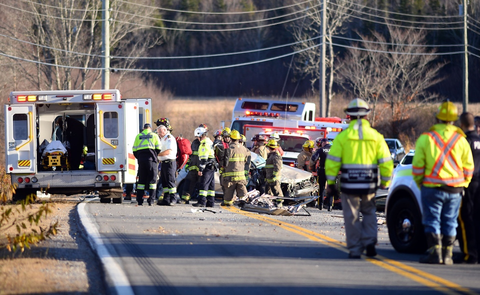 Police say the collision occurred when the driver of a Chrysler sedan was attempting to pass other vehicles and struck an oncoming Volkswagen – spraying wreckage on the road and bringing out a flurry of emergency personnel and flashing lights. (Bill Roberts)