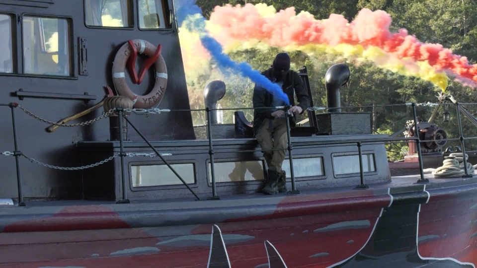 Aboard Seaquarium's Shame, White sets off colourful smoke bombs that are intended to obscure whale watchers' views of the whales and create a floating work of art. (CTV)