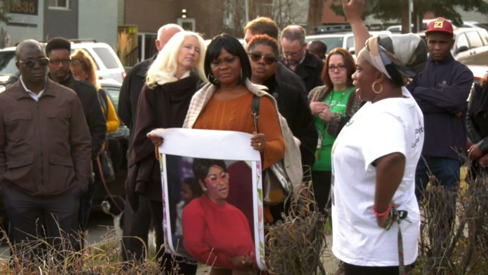 Supporters of Deborah Onwu's family took part in a vigil on Saturday evening at the spot where she was murdered. Her sister says she wants more rules to help protect caseworkers in Canada.