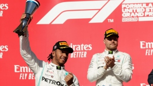 Mercedes driver Lewis Hamilton, of Britain, celebrate following the Formula One U.S. Grand Prix auto race at the Circuit of the Americas, Sunday, Nov. 3, 2019, in Austin, Texas. (AP Photo/Eric Gay)