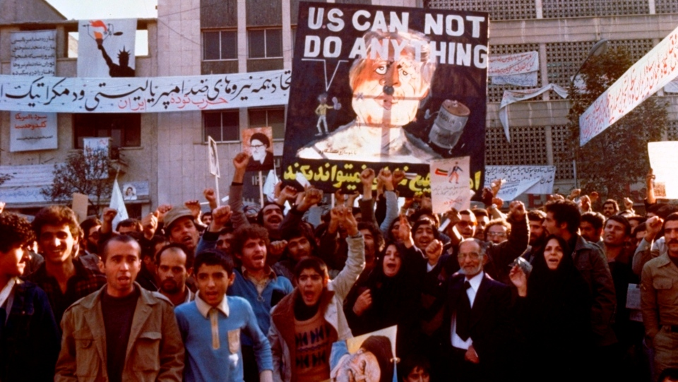 FILE - In this Nov. 8, 1979 file photo, protesters chant outside the U.S. Embassy in Tehran, Iran. Forty years ago on Nov. 4, 1979, Iranian students overran guards to take over the U.S. Embassy in Tehran, starting a 444-day hostage crisis that transfixed America. (AP Photo, File)