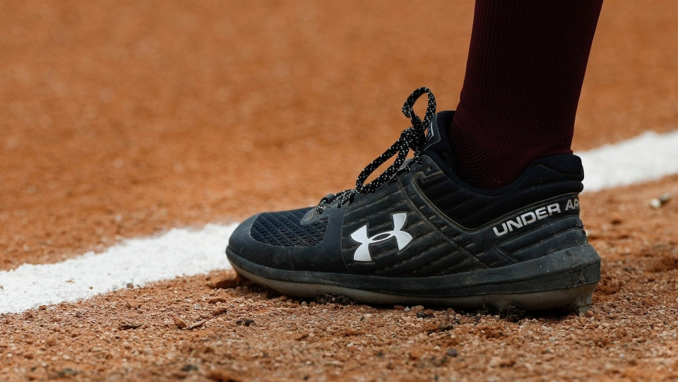 This April 5, 2019, file photo shows a detail view of the Under Armour logo on a cleat during an Grambling State University at Texas Southern University NCAA softball game in Houston. (AP Photo/Aaron M. Sprecher, File)