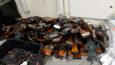 A pile of firearms recovered from a Kitchener home