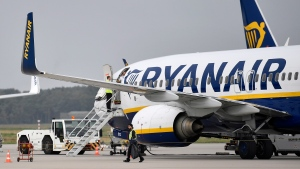 In this Sept. 12, 2018 file photo, a Ryanair plane parks at the airport in Weeze, Germany. (AP Photo/Martin Meissner, File)
