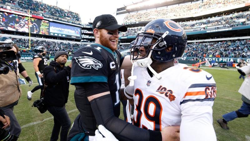 Philadelphia Eagles' Carson Wentz, left, and Chicago Bears' Eddie Jackson (39) meet after an NFL football game, Sunday, Nov. 3, 2019, in Philadelphia. (AP Photo/Chris Szagola)