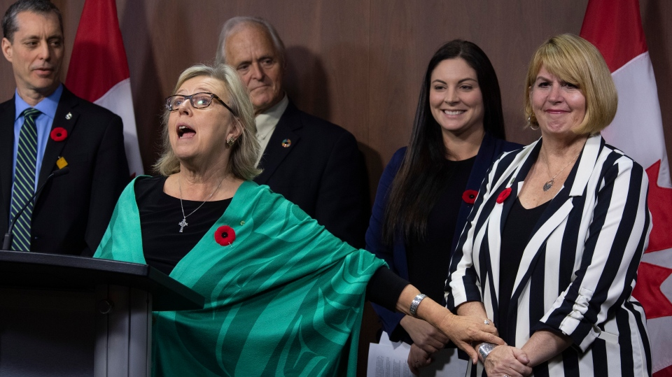 Green MP Paul Manly, left, John Kidder, and Green MP Jenica Atwin look on as party leader Elizabeth May announces Jo-Ann Roberts as the interim party leader during a news conference in Ottawa, Monday November 4, 2019. THE CANADIAN PRESS/Adrian Wyld