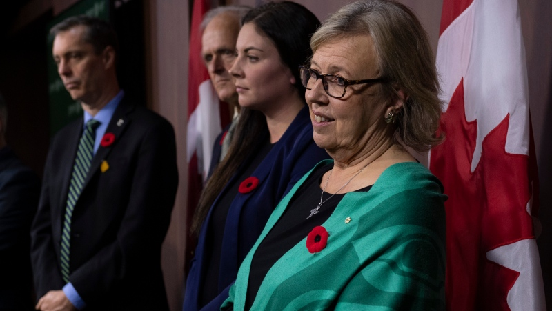 Green Party leader Elizabeth May stands with Green MP Paul Manly, her husband John Kidder, and Green MP Jenica Atwin during a news conference in Ottawa, Monday November 4, 2019. THE CANADIAN PRESS/Adrian Wyld