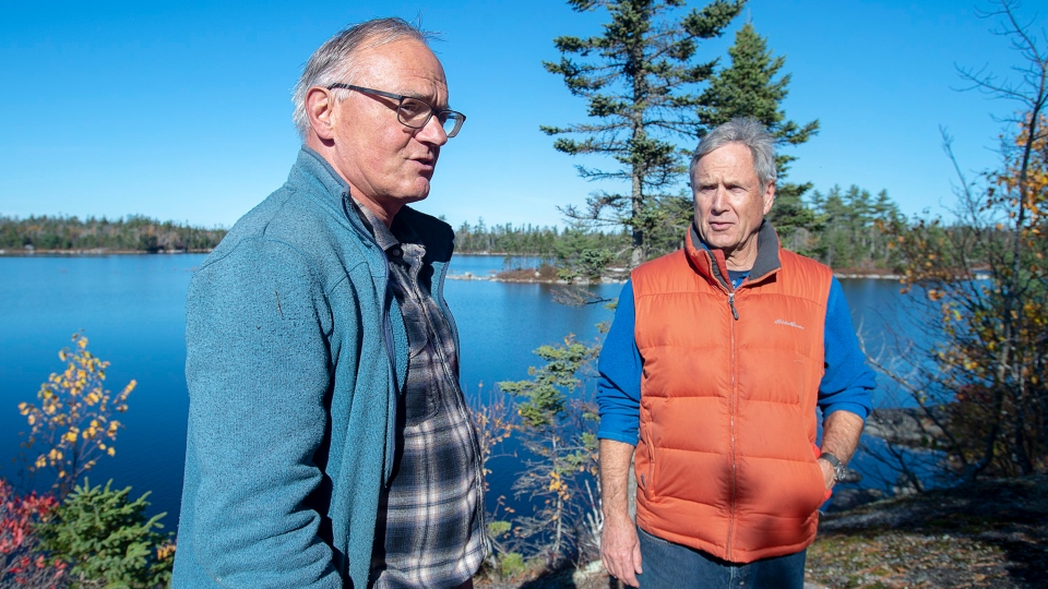Dusan Soudek, left, chats with his friend James Boyer at Susies Lake in the Blue Mountain-Birch Cove Lakes Wilderness Area, one of the largest urban parks in the country, in Halifax on Tuesday, Oct. 29, 2019. (THE CANADIAN PRESS/Andrew Vaughan)