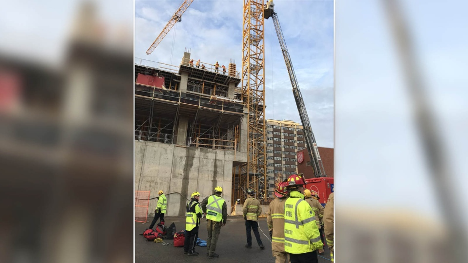 High angle rescue underway atop crane