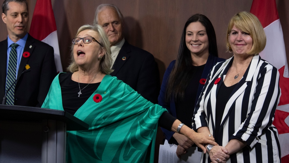 Green MP Paul Manly, left, John Kidder, and Green MP Jenica Atwin look on as party leader Elizabeth May announces Jo-Ann Roberts as the interim party leader during a news conference in Ottawa, Monday November 4, 2019. May announced she is stepping down as the party leader. THE CANADIAN PRESS/Adrian Wyld