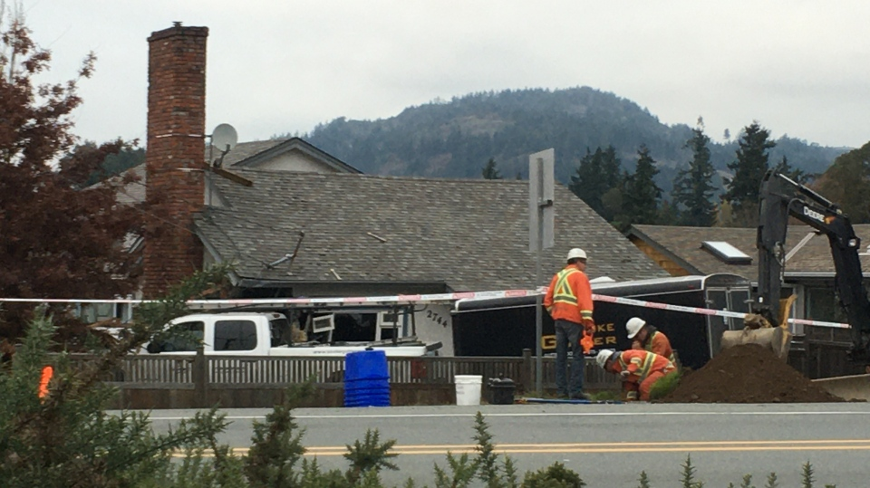 There were children in the room of the home where the truck hit but no one inside was injured. (CTV Vancouver Island)