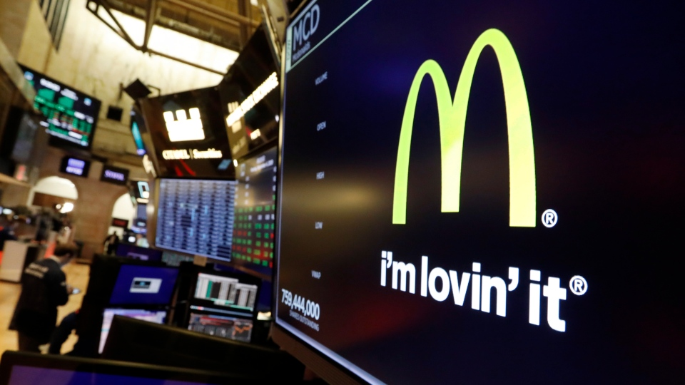 The logo for McDonald's appears above a trading post on the floor of the New York Stock Exchange, Monday, Nov. 4, 2019. (AP Photo/Richard Drew)