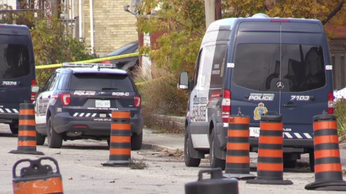 Police vehicles seen here on Weber Street East after a fight left two men with stab wounds.