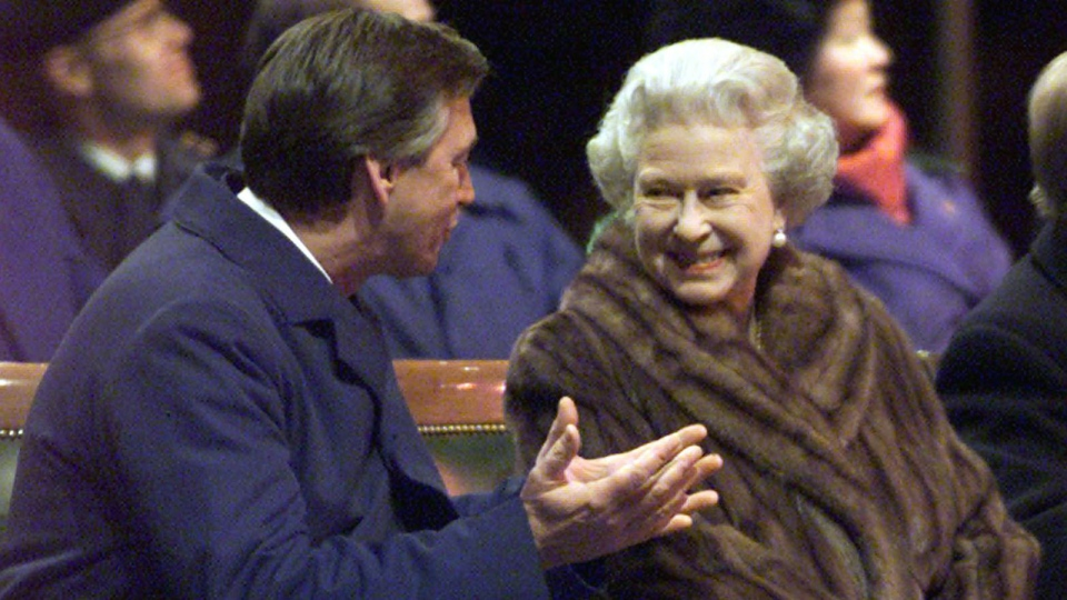 Queen Elizabeth II smiles and talks with Gary Doer, then the premier of Manitoba, while wearing a fur coat during ceremonies in Winnipeg on Tuesday Oct. 8, 2002. (CP PHOTO/Adrian Wyld)