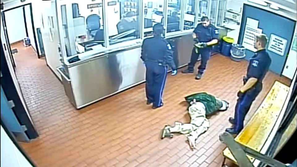 Corey Rogers lies on the floor under police custody at the Halifax police station, wearing a spit hood at about 11 p.m. on June 15, 2016, in this still image taken from surveillance video provided by Nova Scotia Courts.  (THE CANADIAN PRESS/HO, Province of Nova Scotia Courts)