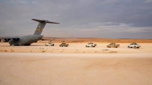 In this Oct. 25, 2019, photo, released by the U.S. Army Reserve, pickup trucks are vehicles lined up to be loaded onto a cargo plane as part of the deliberate withdrawal of coalition forces from northern Syria at the Kobani Landing Zone (KLZ). (U.S. Army Reserve photo by Staff Sgt. Joshua Hammock via AP)