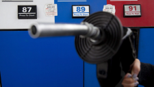 Gas prices are displayed as a motorist prepares to pump gas at a station in North Vancouver on May 10, 2011. (Jonathan Hayward / THE CANADIAN PRESS)