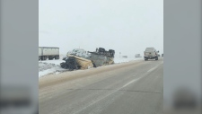 Upside down vehicle in ditch near Lacombe