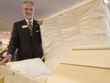 Don Smith of Smith's Funeral Homes in Burlington, Ontario, shows off an eco-friendly casket.