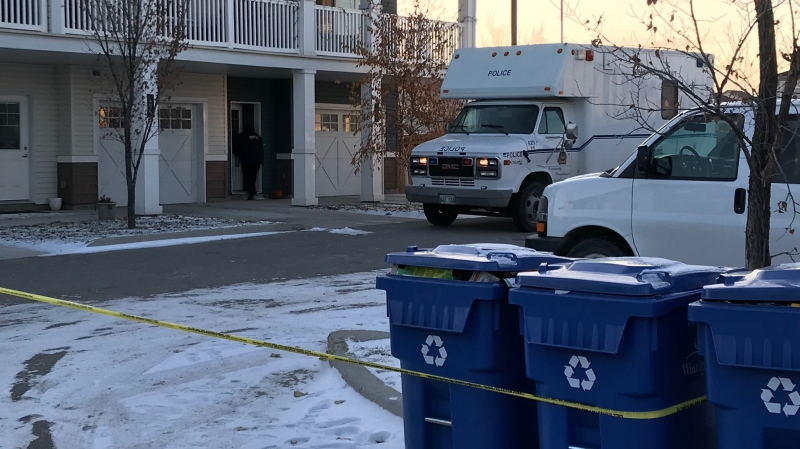 A police identification unit at the scene of a homicide investigation on Tim Sale Drive. (Josh Crabb/CTV News Winnipeg.)