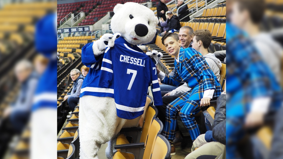Brock Chessell attends a Toronto Maple Leafs game in Toronto, Ont. as part of the Air Canada Fan Flight program. (Family photo)