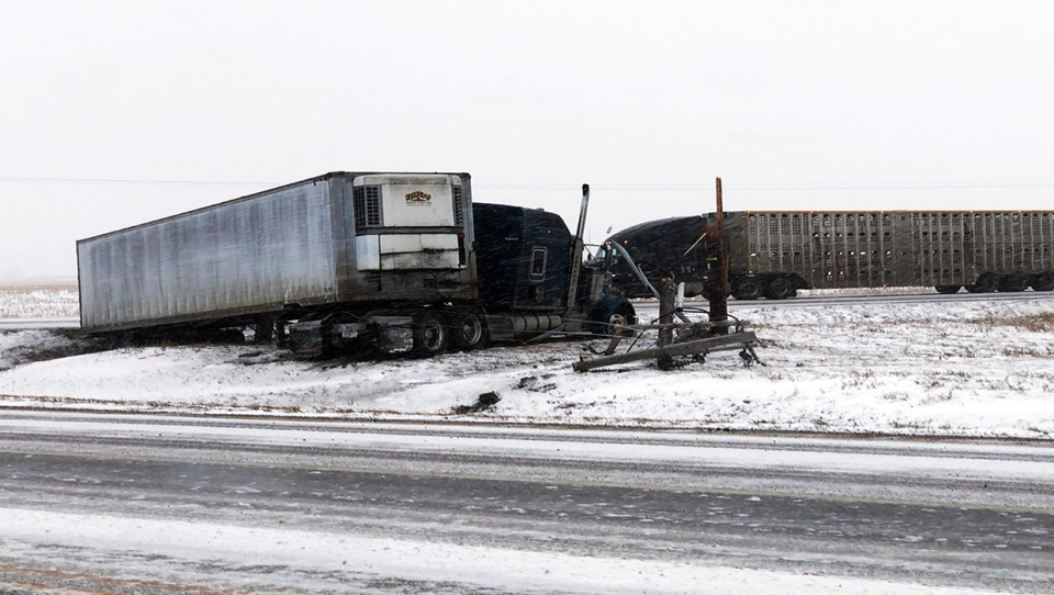 A truck jacknifed on Highway 845