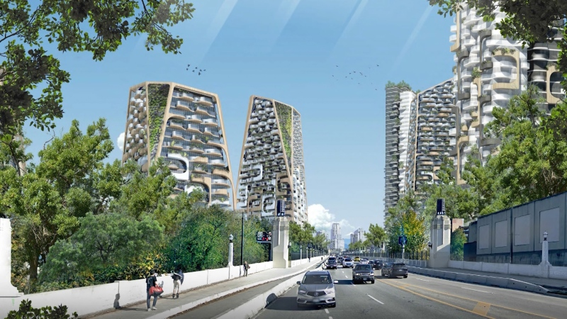 A rendering shows some of the 11 proposed towers of the Sen̓áḵw development project on both sides of the Burrard Street Bridge. (Revery Architecture)