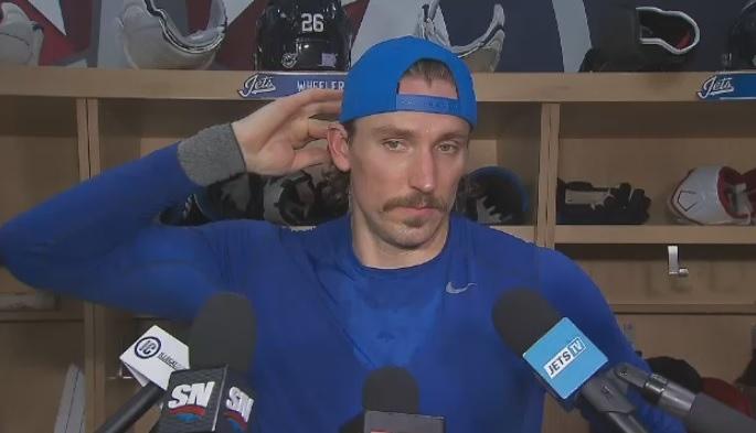 Jets' captain Blake Wheeler addresses the media.