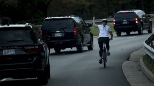 The cyclist who flipped off President Donald Trump's motorcade in 2017, and lost her job because of it, has won her bid for local office in Virginia. (AFP)