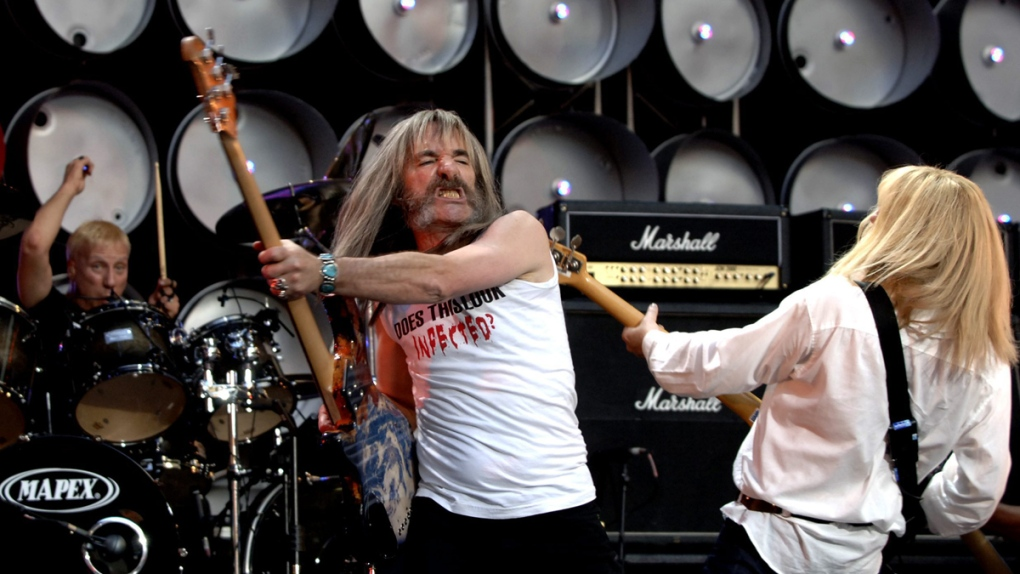 Henry Shearer performs with Spinal Tap