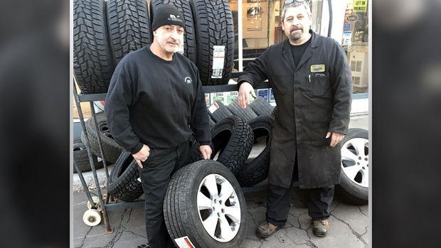 Albert Saikaley and Nick Dirienzo busy with snow tire changes