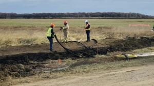 Workers survey the damage of a pipeline leak in a field near Edinburg, N.D.  (TC Energy Corp. / THE CANADIAN PRESS / HO)