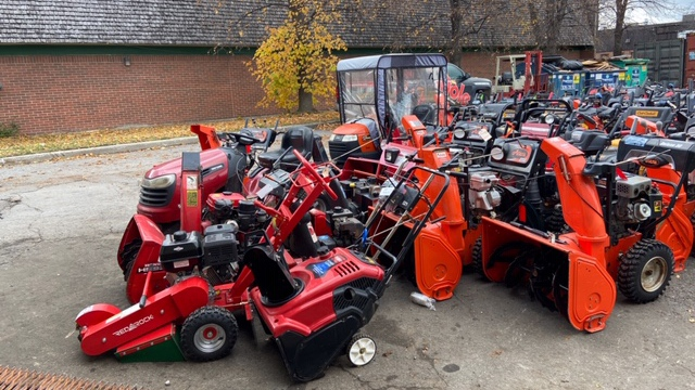 Snow blowers waiting for maintenance.